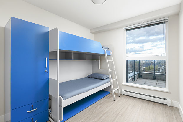 Economy Shared Bedroom at GEC Pearson student housing features one bunk bed for two students