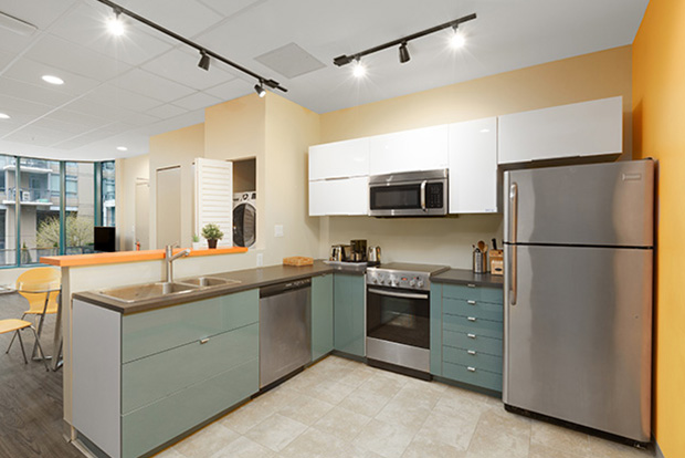 Fully equipped kitchen at GEC Viva apartments in Downtown Vancouver