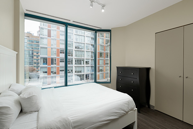 Bedroom with queen bed at GEC Viva downtown apartments