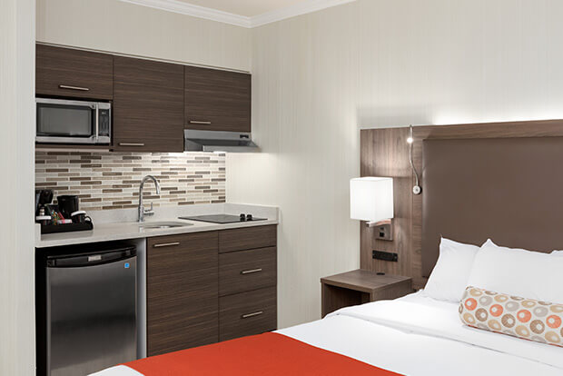 Fully equipped kitchenette with induction stove at Downtown Vancouver GEC Granville Suites long term extended stays hotel