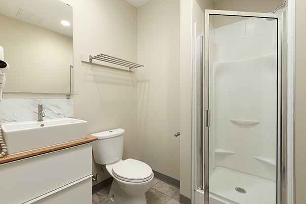 Bathrooms at GEC Viva student residence include a standing shower