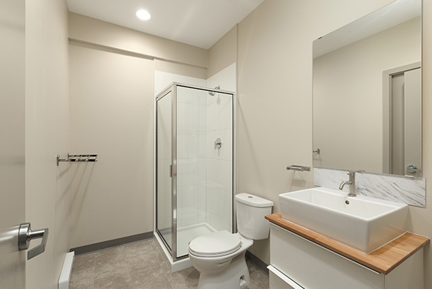 Bathrooms at GEC Viva in Downtown Vancouver include a standing shower