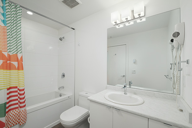 Bathrooms at GEC Burnaby Heights apartments in Vancouver include a soaking bathtub and standing shower