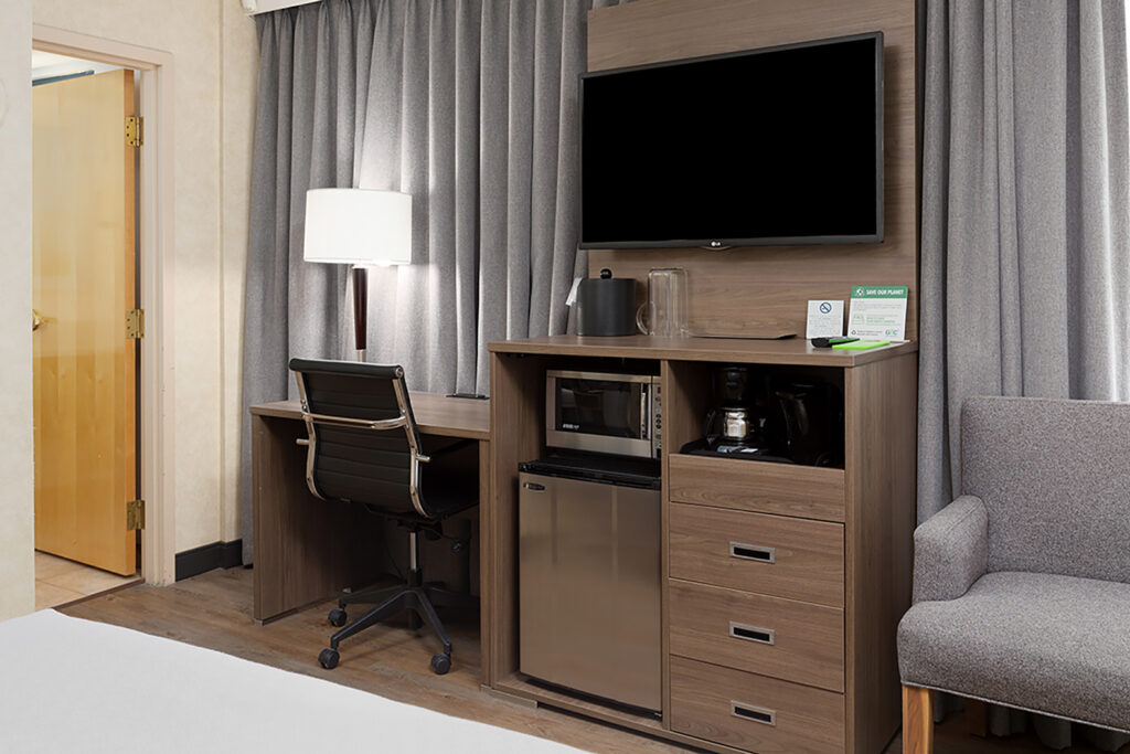 Downtown Vancouver GEC Granville Suites long term extended stays hotel premium furnished rooms with flat screen TV, desk, chair, mini fridge, and microwave