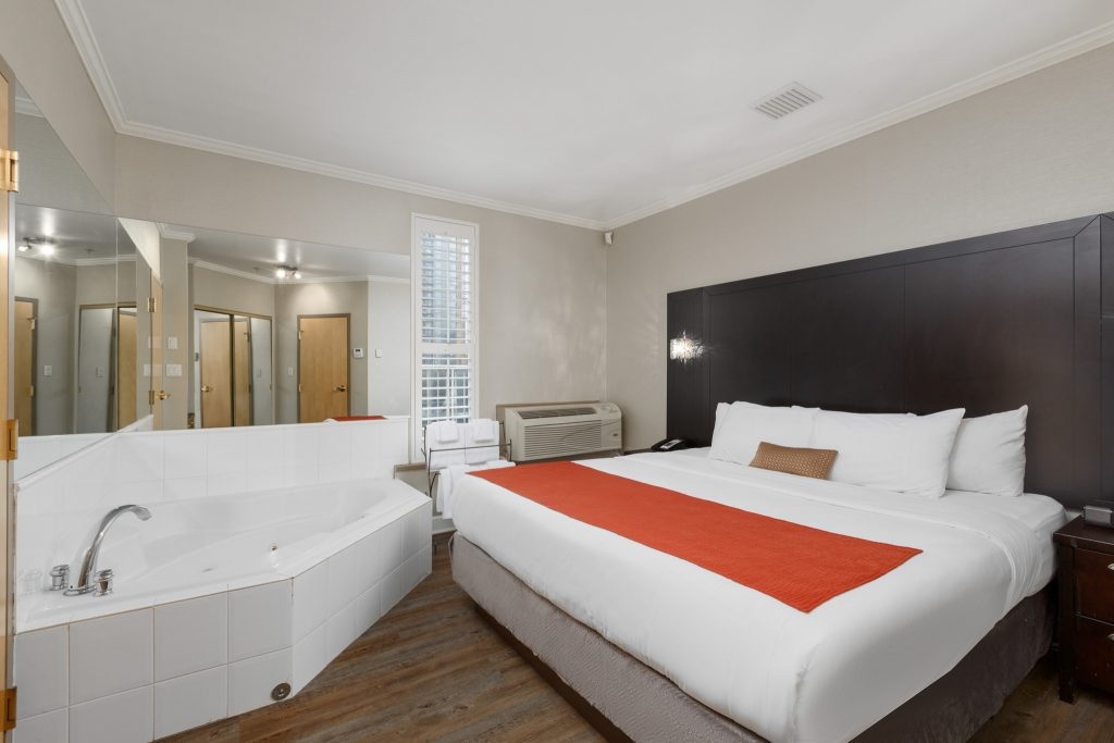 Downtown Vancouver GEC Granville Suites long term extended stays hotel premium penthouse with California king size bed and jacuzzi hot tub