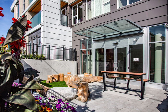 Beautiful outdoor common area and garden at GEC Pearson student housing in Vancouver