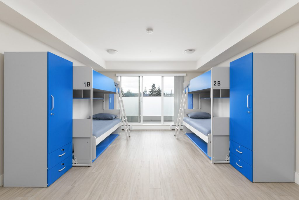 Quad Shared Bedroom at GEC Pearson student residence in greater Vancouver features two bunk beds for four students in a private apartment