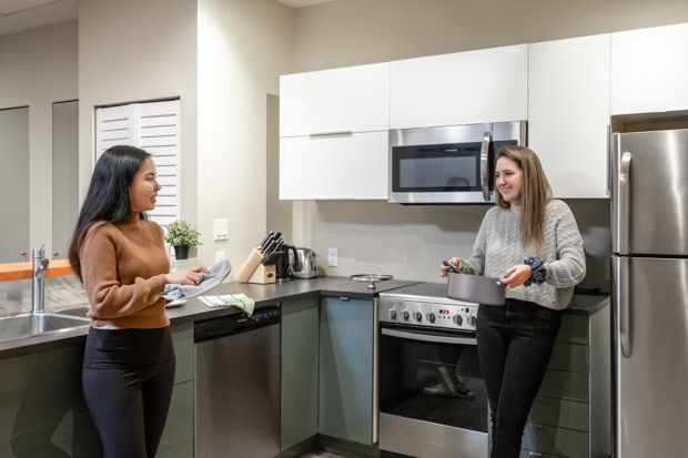 GEC Viva two students in the kitchen of a private bedroom
