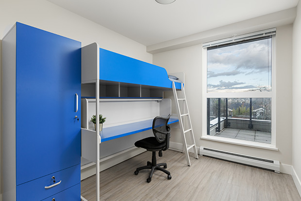 Private Bedrooms at GEC Pearson include one convertible loft bed with a desk for each student