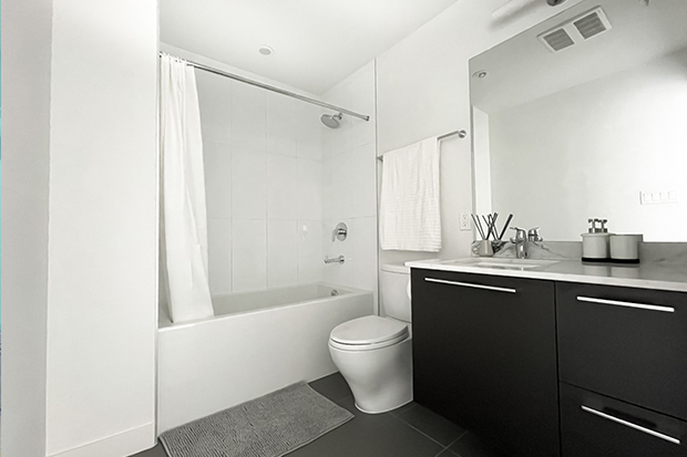 Bathroom with bathtub and shower at GEC Marine Gateway apartments for rent