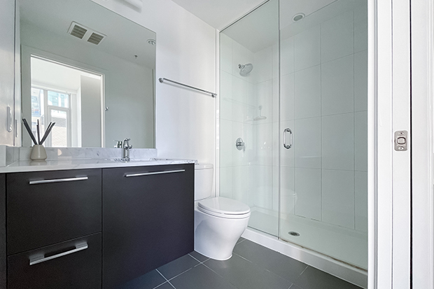 Bathroom with shower in GEC Marine Gateway residence in Vancouver