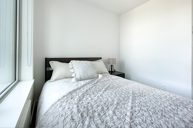 Private bedroom in GEC Marine Gateway apartments on Cambie and Marine Drive