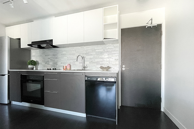 Fully equipped kitchen at GEC Marine Gateway student apartments in Vancouver