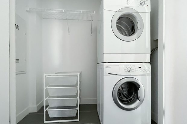 In-unit laundry machines at GEC Living apartments in Marine Gateway