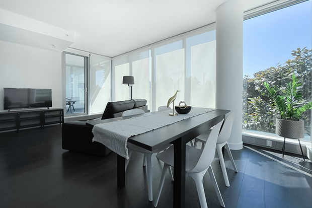 Dining and living room overview in a 2 bedroom apartment rental at GEC Marine Gateway