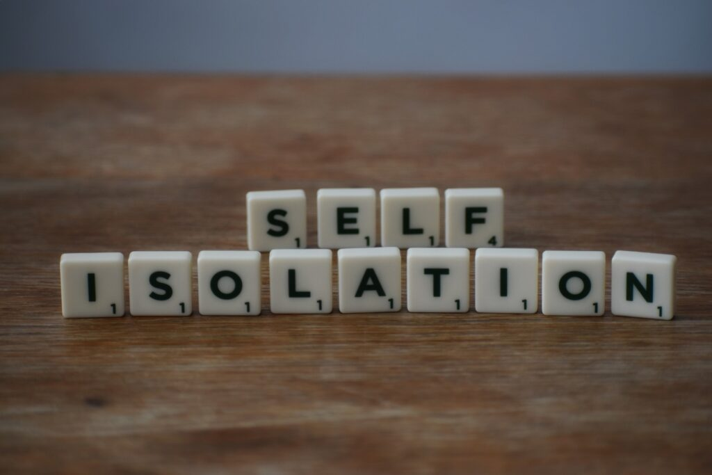 Self Isolation phrase formed using individual scrabble letters