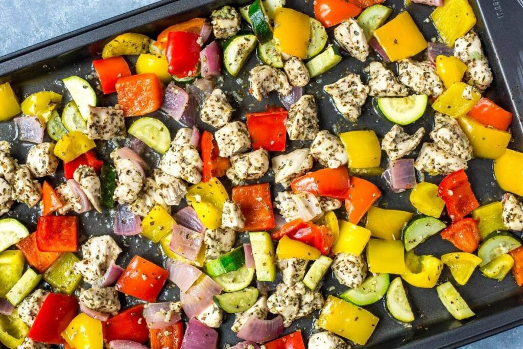 Chicken, red and yellow peppers, zucchini and red onion cut in cube shaped pieces