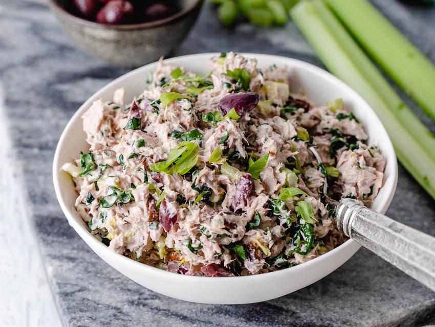 Tuna salad with tuna, onions, greens and mayo in a bowl